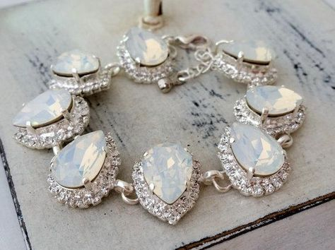 #weddings #jewelry #earrings #bridalearrings #extralargeearrings #chandelierearrings #crystalearrings #swarovskiearrings #statementearrings #bridesmiadsgift #weddingjewelry #largeearrings #clusterearrings #whiteopalearrings #gatsbystyle
