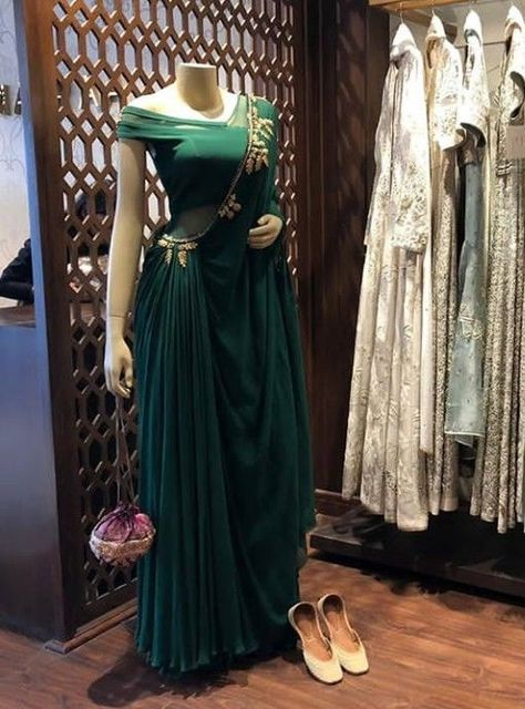 Beautiful Saree Style viscos Dress with Saree style drape. Modern silhouette with traditional embellishments. Embellished with hand embroidery work.