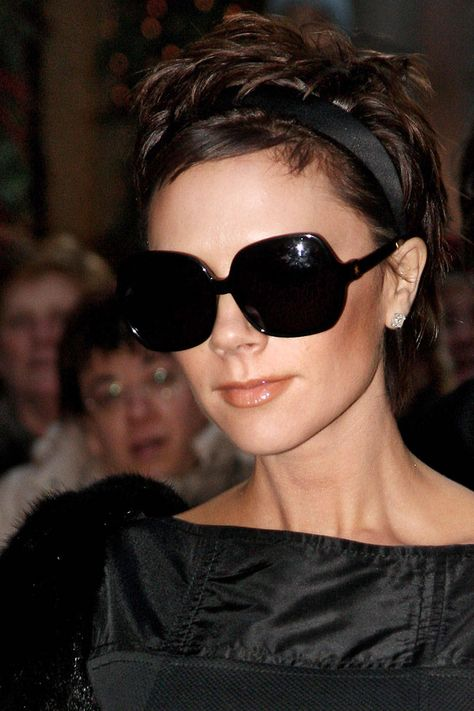 """Victoria Beckham, 2008 - Some refer to it as the """"poxie."""" We prefer to simply call it the chic hairstyle that marked her transition from pop star Posh Spice to fashion star Victoria Beckham. She unveiled the look at the same time she unveiled her first ready-to-wear collection at New York Fashion Week."""