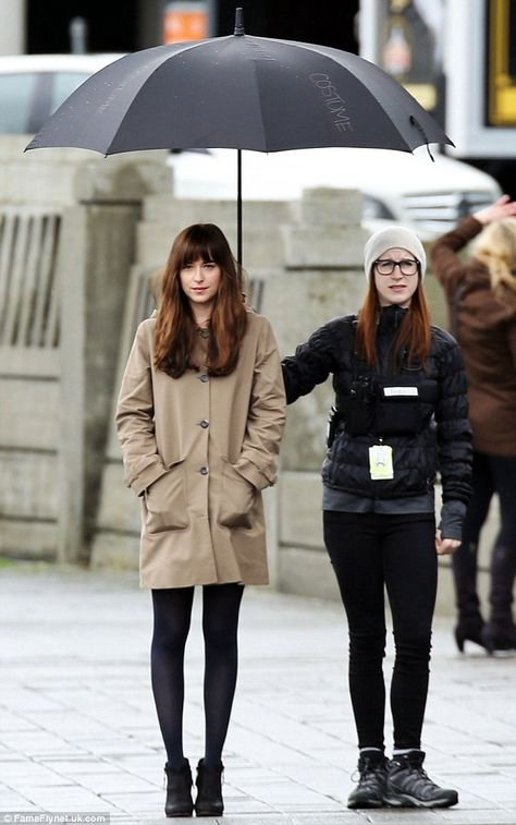 She's got her covered: Even the rain didn't dampen Dakota's spirits, especially as she was...