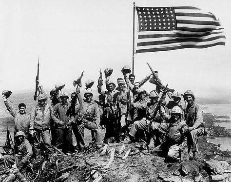 Iwo Jima, Marines pose in front of the flag they just raised