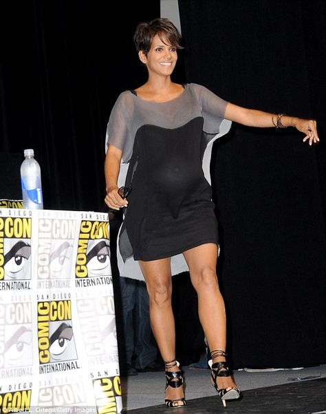 Gray Lady from Fashion Spotlight: Halle Berry The actress takes to the stage at Comic-Con for the X-Men: Days of Future Past panel sporting a loose gray-and-black shift dress and ankle-strap heels.
