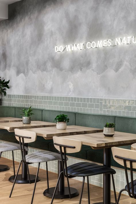 Farmer J restaurant in London boasts grey surfaces and green accents