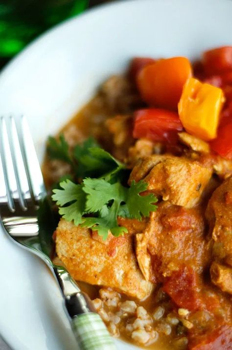 Crock Pot Chicken Tikka Masala is a slow cooker Indian dish of boneless chicken, marinated in spices and yogurt. An easy weeknight meal. #reluctantentertainer #crockpotchickentikkamasala #tikkamasala #crockpotmeal
