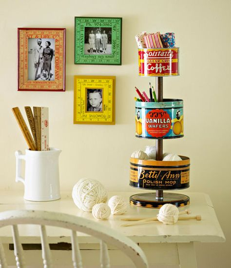 Corral crafts supplies in a three-tiered stand made from vintage tins.