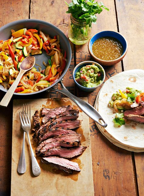 Like those build-your-own burrito bars? Then you'll love this meal that mashes up burritos and fajitas into one easy-prep dish. Grilled flank steak, bell peppers, and zucchini fill our tasty Mexican burrito recipe.  #mexicanfoodrecipes #easy #best #bhg