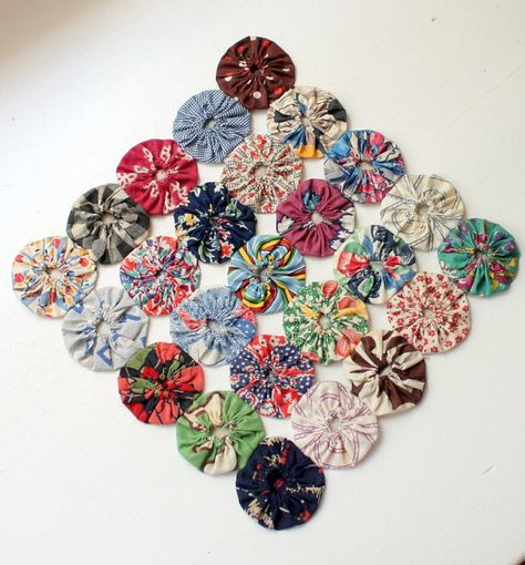 These are fun and easy to make!  Vintage Feedsack Fabric Yoyo Table Mat Doily by mitziscollectibles, $10.00