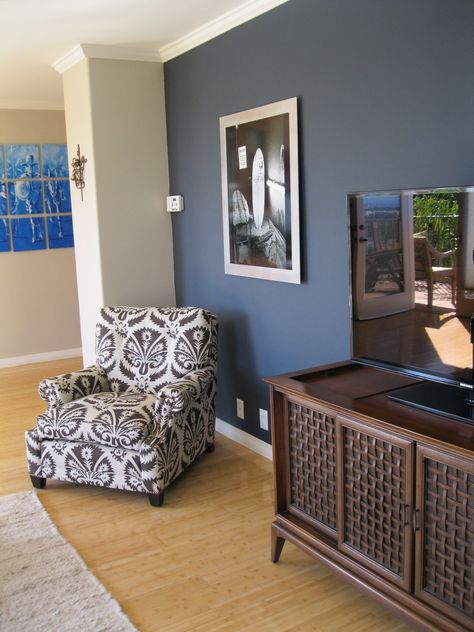 shade of blue on wall camoflauges tv. love the chair too!