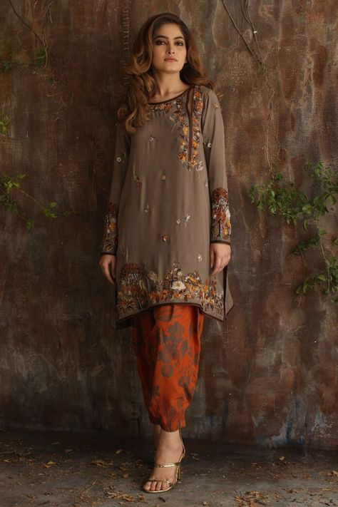 My favorite by Nida Azwer, a Crepe Silk Shirt with hand worked Embroidery and Printed Crepe Silk Shalwar. For a perfect Mehndi dress you can pair it with an Indian Chanderi Silk Woven Dupatta.