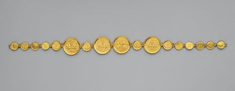 "Girdle with Coins and Medallions, ca. 583. Byzantine; Found in 1902 at Karavás, Cyprus (reassembled after discovery). Gold. .... ""Old coins were frequently used for jewelry, since under later rulers their historic value and their worth in gold often exceeded their worth as currency. All the coins and medallions are stamped CONOB, an abbreviation for Constantinopolis obryzum (""pure gold of Constantinople""), indicating that they were minted in the capital."" [Go Green!] lol."