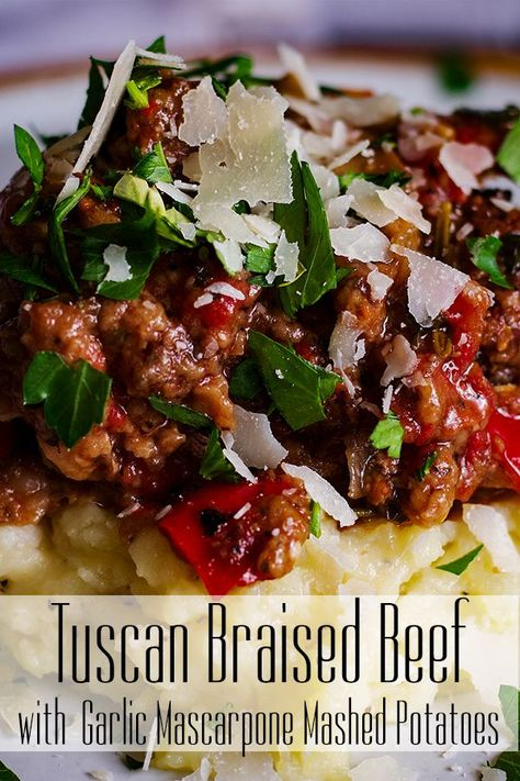 Tender braised beef in a rich wine sauce with mushrooms, onions, garlic, red bell pepper, and tomatoes served over creamy garlic mascarpone mashed potatoes. #beef #braised #mashedpotatoes #Italian #comfortfood #fallrecipe #winterrecipe #slowcooked | alittleandalot.com