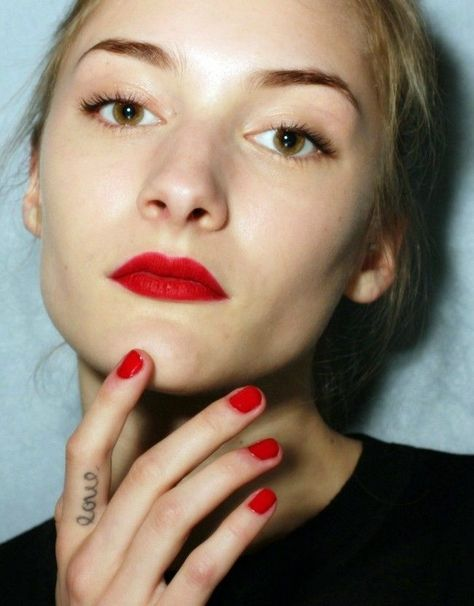 Red lips and matching nails for a fresh update on a traditional look. Minimal make up and understanded attire makes for pared down glam and an ultra cool look. I will be trying NARS Audacious lipst.