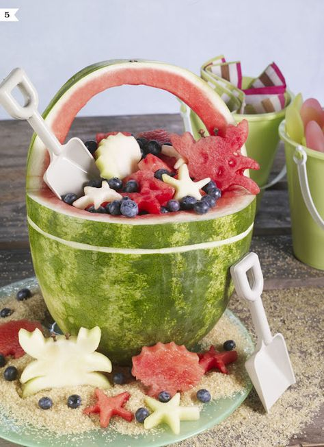 Beach party food ideas | Watermelon beach bucket, clever and (maybe) not so hard to make.  Crabs and other critters are cup out with beach themed cookie cutters.