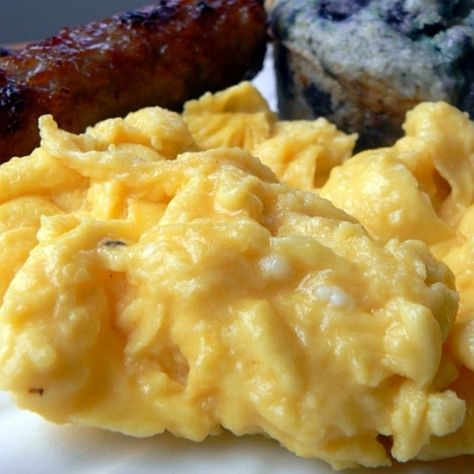 Creamy Scrambled Eggs recipe: Special version of an old breakfast favorite. Fluffy Scrambled Eggs, Scrambled Eggs With Cheese, Cream Cheese Scrambled Eggs, French Scrambled Eggs, Fluffy Eggs, Ham And Eggs, Egg Recipes For Breakfast, Breakfast Dishes, Recipes