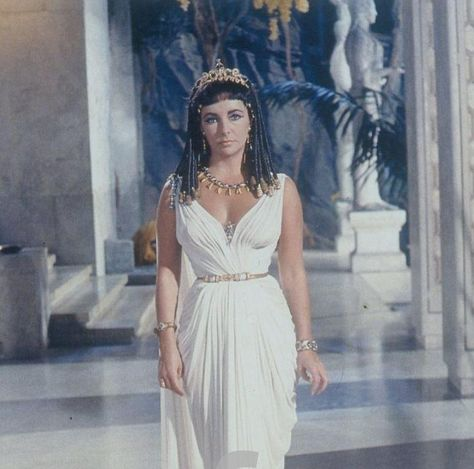 Queen of the Nile: Elizabeth Taylor testing Oliver Messel costumes for CLEOPATRA (1963), at Pinewood Studios. Description from tumblr.com. I searched for this on bing.com/images