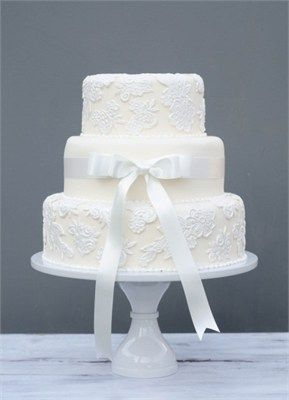 Champagne Lace wedding cake *I LOVE the middle tier plain & simple with a bow... this mixed with the pressed-on lace cake is PERFECT!