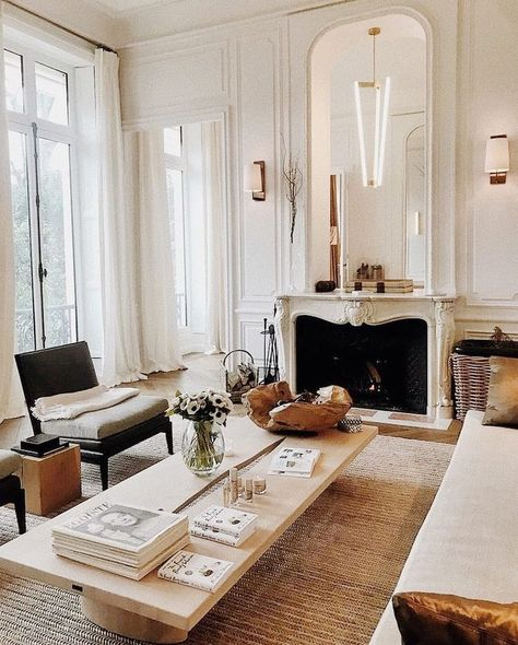 Floor to ceiling windows, French doors, molding, antique fireplace. Home decor design ideas inspiration.