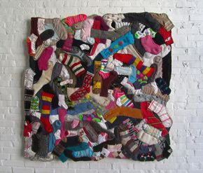 sock rug, cool way to use up all the odd socks the washer