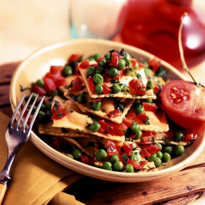 Have a quick and tasty dinner on the table in less than 20 minutes! Fresh cheese-filled ravioli is tossed with store-bought pesto and topped with a no-cook sauce of ripe tomatoes and fresh basil.