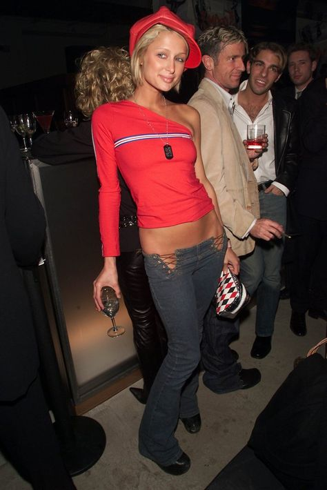 A look back at Paris Hilton's best, boldest, and most outrageous outfits from the early from Juicy Couture and Von Dutch to rhinestones and low-waist jeans.