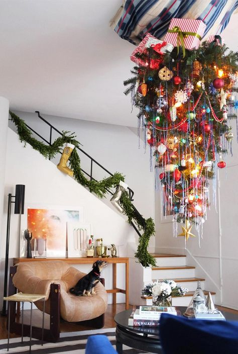A Christmas tree hanging upside down with colorful ornaments