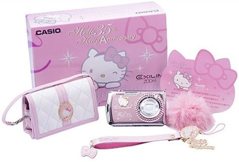 Pink Hello Kitty Camera- ohmygosh!! this is SO perfect for mees! I neeeed a new camera... & its HELLO KITTY... want! NEED! tehehehe <3 <3 <3