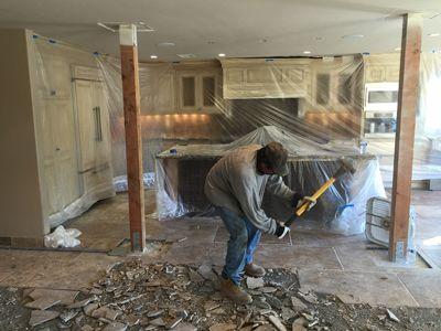 Demolishing Kitchen Tile With A Sledgehammer    Http://masterdemolitioninc.com/kitchen