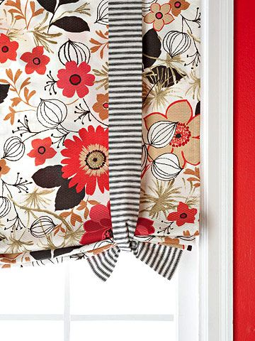 DIY Roman Shade    Fashion an easy window treatment by pairing a finished rectangle of fabric with two sets of contrasting ties. Gather the fabric to the desired length and knot the ties, then hang the fabric from a tension rod.