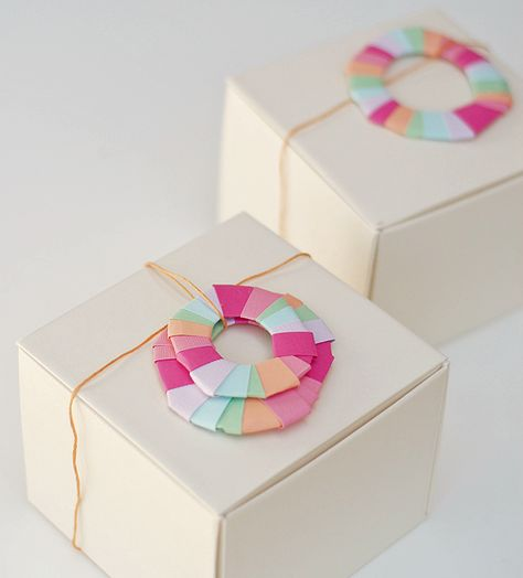 diy paper wreaths make even a plain box into a perfectly wrapped gift