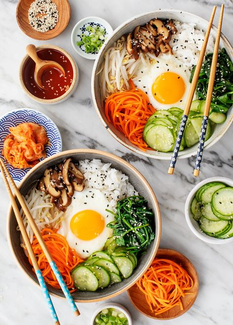 This bibimbap recipe is SO delicious and easy to make! A vegetarian version of the Korean rice bowl, it includes seasoned vegetables, a sunny side up egg, and spicy gochujang sauce. | Love and Lemons #bibimbap #rice #plantbased #vegetarian #cleaneating