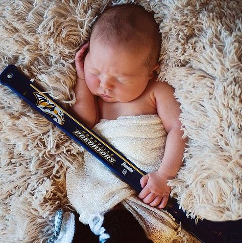 """In March, Carrie and Mike put a hockey stick in Isaiah's hands, giving a cute nod to his dad's team and writing, """"The Predators are in the playoffs! Just waiting to get called up!"""""""