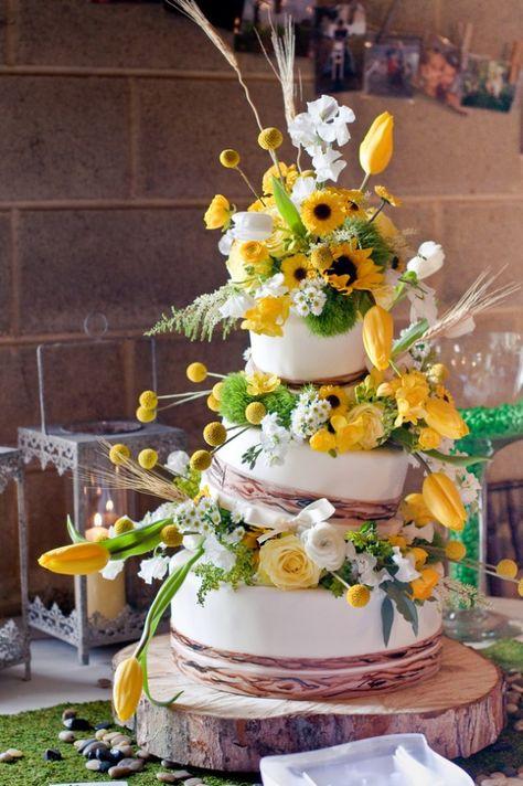 Sunflower Theme Wedding Cake-really nice flower and cake arrangement
