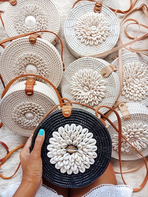 Roundie Shellsis perfect to get chic yet classy look. Roomie enough to store your daily or beach essentials. Features Woven Ata Genuine Leather Strap Leather Clip Closure White and Brown Shells Traditional Motives Batik Lining or Any Kind of custom fabric you want to just contact us for inquires. Measurement approxim