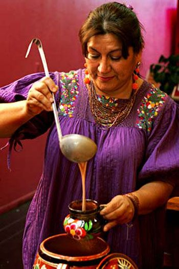 """Champurrado, """"a rich, creamy drink made from Mexican chocolate, thickened with masa, and spiked with cinnamon."""""""