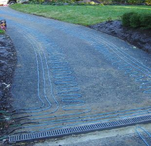 Heated tire tracks allow use of steep driveway during storms heated tire tracks allow use of steep driveway during storms snow melting and heated driveways pinterest driveways driveway ideas and house solutioingenieria Choice Image