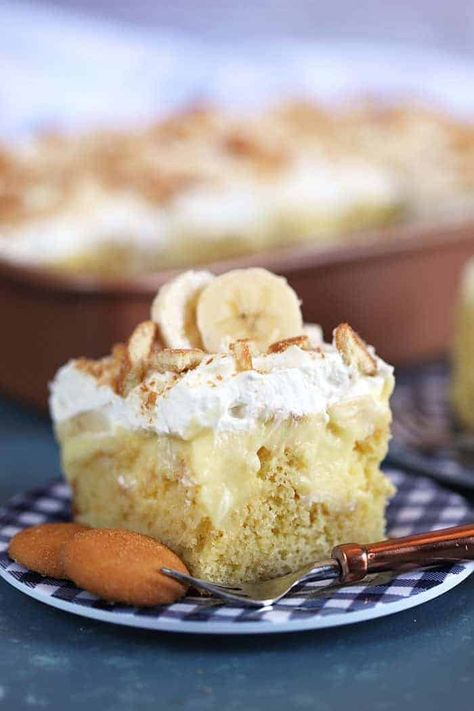 If you have never had banana pudding before this Banana Pudding Cake is a good way to jump right in and become obsessed! #pokecake #bananapokecake #bananapuddingpokecake #bananapuddingcake #bananacake #spendwithpennies #puddingcake #easycake #banana #cake #easydessert