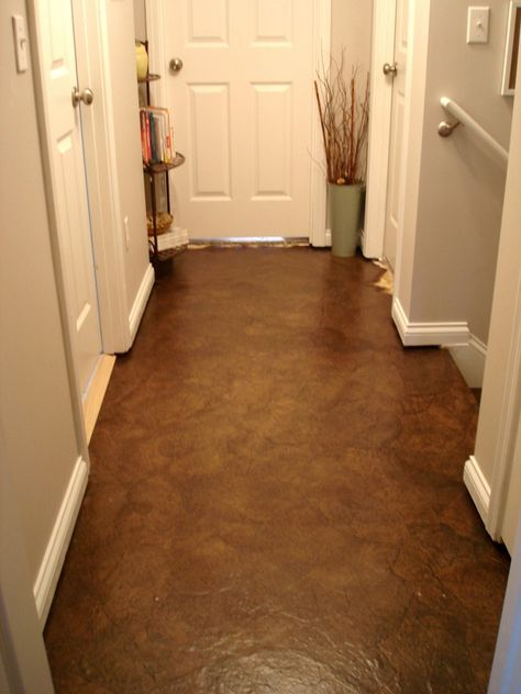Brown Paper Bag Floors... I do believe I might do this in my office/basement space... seems appropriate to have a paper floor!