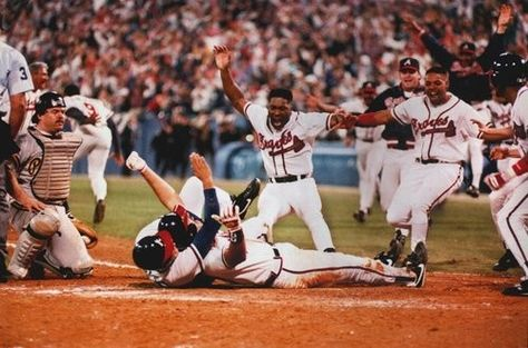 "Atlanta Braves: 1992 - The slide heard around the world (Sid Bream). I still get chills when I remember Skip Caray saying ""Swung, line drive left field! One run is in! Here comes Bream! Here's the throw to the plate! He is...safe! Braves win! Braves win! Braves win! Braves win!...Braves win!"""