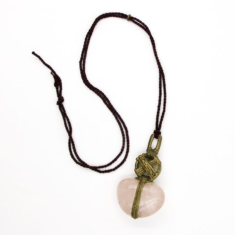 """These treasured works from the collection were created by LoU's own hands in his studio at the iconic La MaMa Experimental Theatre Club during the early 1980's and 90's in NYC. Gathering all these various components throughout his world travels... LoU described these works as possessing a kind of magic ... that is transferred from creation to owner and then into the owner's world... in his words they are """"Good For Your Life"""" these pendants are """"Truthful at Heart"""" A beautiful piece of rose quartz"""