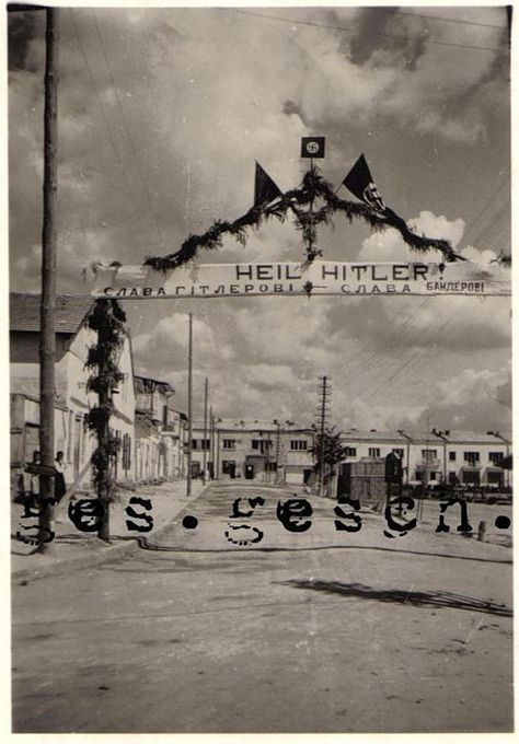 """6.1941 - Lwów, Poland: """"Glory to Hitler, glory to Bandera!"""" A welcome sign to the entering German and  Organization of Ukrainian Nationalists (OUN) troops. Stepan Bandera (1909-1959) was a Ukrainian revolutionary politician and one of the leaders in Western Ukraine (Galicia), who headed the OUN. He was responsible for the proclamation of an Independent Ukrainian State in Lwów on 6.30.1941, eight days after Germany's attack against the USSR."""