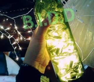 Lampara con botella de vidrio