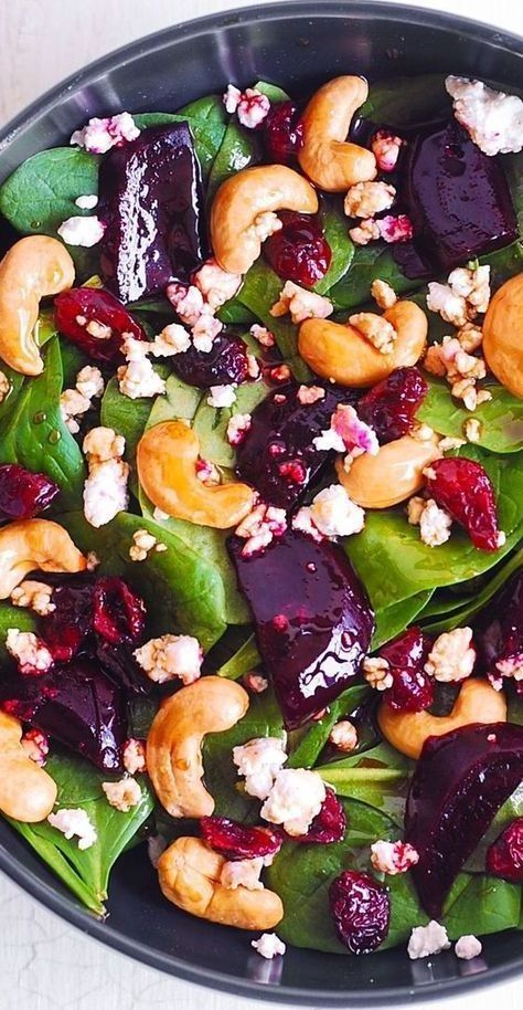 Beet Salad with Spinach, Cashews, Cranberries, and Goat Cheese with honey, lemon and olive oil dressing.  Healthy, gluten free, Mediterranean-style salad, packed with fiber and nutrients.  Goat cheese adds a touch of creaminess, while the cashews add a bit of crunch to this healthy beet salad. #beets #salad #beetsalad #spinach #cashews #cranberries #goatcheese