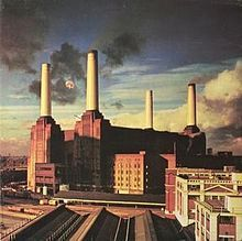 Picture of factories with tall chimneys pouring out black smoke.
