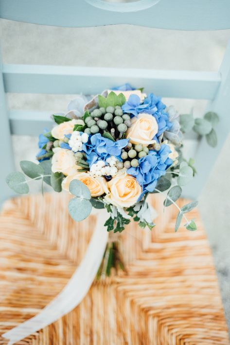 Natural colours of the earth and the sea for this romantic bride bouquet with blue hydrangeas, peach roses, silver grey Brunia berries and eucalyptus, tied with white ribbon for a Greek island wedding in Lefkada. By @lefkasweddings with @gouriotiflowers and @lefteriskalampokas