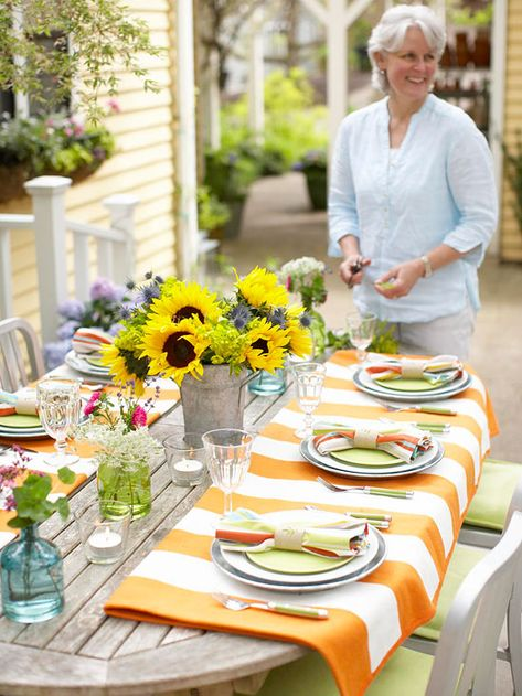 If your table is too large for a tablecloth, buy two of the same tablecloths and drape them over the ends of your table. More outdoor entertaining ideas: http://www.bhg.com/party/birthday/themes/easy-outdoor-entertaining-tips-and-ideas/?socsrc=bhgpin061412
