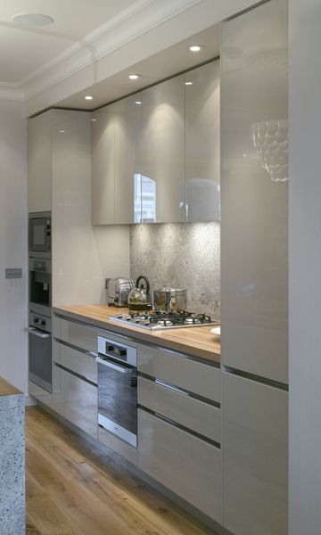 Roundhouse Grey Urbo Bespoke Kitchen In A Contemporary Style Full Length  Pantry Cabinet Door And Inset Puck Lights