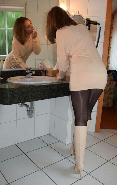 Amazing legs in black shiny pantyhose