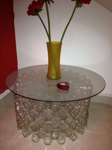 Table made with recycled coca-cola bottles, glued with silicon cold. Was developed day by day, floor by floor and contains approximately 130 bottles! Submitted by: Mauricio Camacho ! #Bottle, #Glass, #Recycled, #Table, #UpcycledFurniture