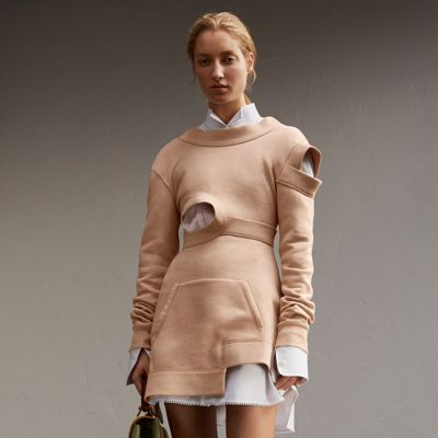 A brushed-back jersey sweatshirt dress with cut-out details in homage to Henry Moore's exploration of hollowed forms. The silhouette is shaped to contour the body with a sports-inspired pouch pocket and drape to the back of the neckline.