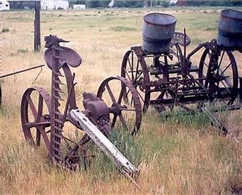 Landscaping With Antique Farm Equipment